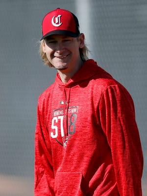 Former Reds pitcher Bronson Arroyo helps out during warmups before practice at the Cincinnati Reds training complex in Goodyear, Ariz., on Wednesday, Feb. 21, 2018.