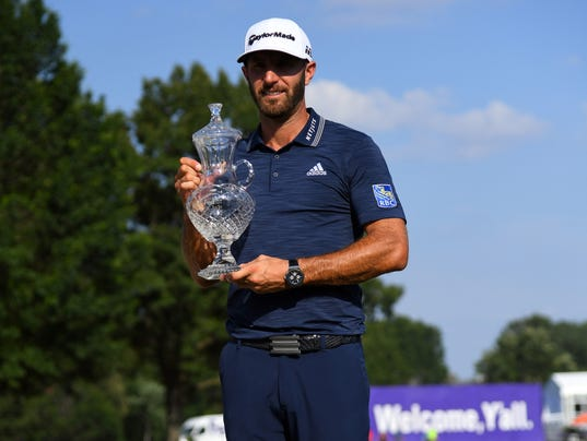 Dustin Johnson with FedEx St. Jude trophy