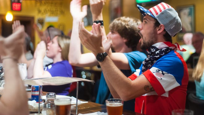 Fans cheer while watching a game on June 22 at Specific Gravity in Salisbury.