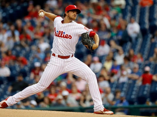 Philadelphia Phillies' Aaron Nola pitches during the first inning of an exhibition baseball game against the Baltimore Orioles, Friday, April 1, 2016, in Philadelphia. (AP Photo/Matt Slocum)