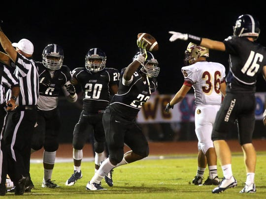 Siegel's Greedy Howse celebrates recovering the ball for a turnover during the week zero game againstRiverdale at Siegel, on Friday,  August  22, 2014.