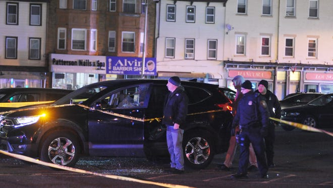 Police at the scene where two people were shot in the parking lot of the D'Classico Restaurant and Lounge, located at 60 Ellison St. in Paterson.
