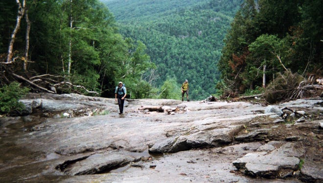 Hikers climb up Cascade Mountain where it flattens and widens on the way to the summit in Keene in the Adirondacks.