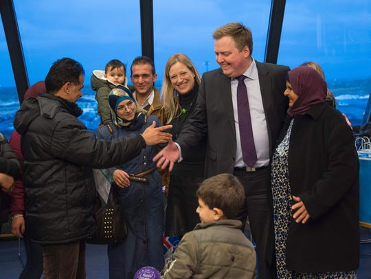 Syrian refugees are welcomed by Iceland's Prime Minister