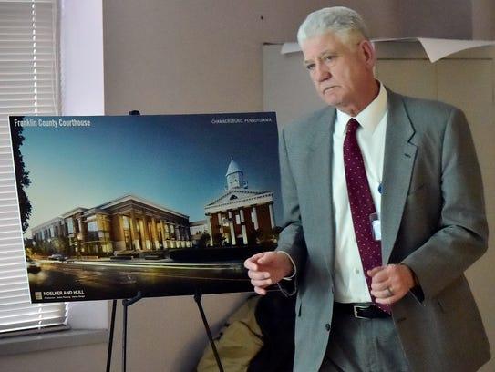 John Hart, project mananger, leqads a meeting to discuss