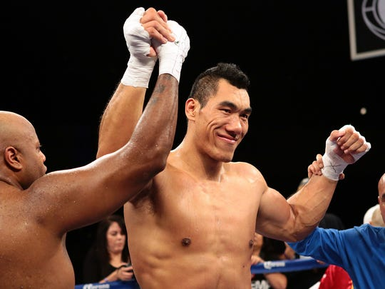 Taishan, a boxer from Beijing, China, is named winner by decision after a four-round heavyweight fight against Roy McCrary of Tenn. (left) on Friday night, February 27, 2015 at Fantasy Springs Resort Casino in Indio, Calif. The fight was on the undercard of a Golden Boy Boxing event.