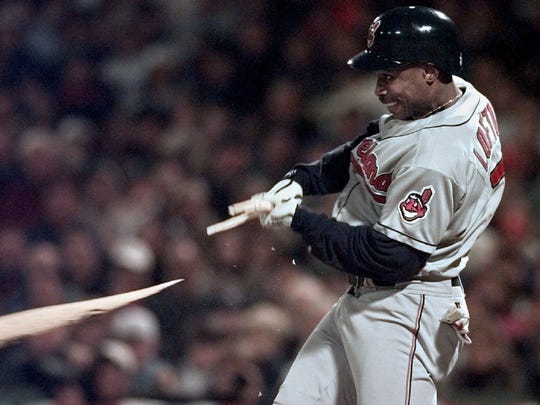 Cleveland Indians batter Kenny Lofton breaks his bat as he smacks a single