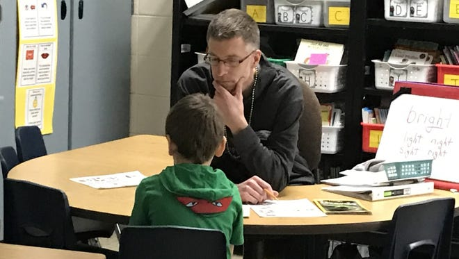 Gary Goelz, a first-grade teacher in the Muskego-Norway School District, works with a student. District leaders have worked proactively to keep teachers and other employees engaged in the aftermath of union-gutting Act 10.