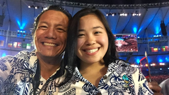 Guam National Olympic Committee Press Attache Jojo Santo Tomas with Olympic swimmer Pilar Shimizu, at the opening ceremonies of the 2016 Rio Olympics.