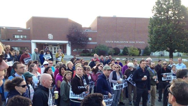 South Burlington teachers gather to picket outside of South Burlington High School Tuesday morning.