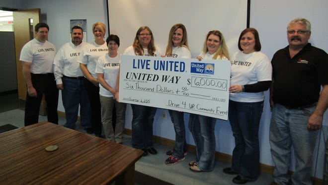 Pictured from left are Brenner Tank Team Members: Lon Hetzel, Dave Hodorff; United Way Honorary Campaign Chair, Kay Luepke; Dawn Marie Peterson; Society Insurance Team Members: Colleen Hahn, Tracy Schneider, Becky Wesenberg, Jill Wendt and John Schwai.