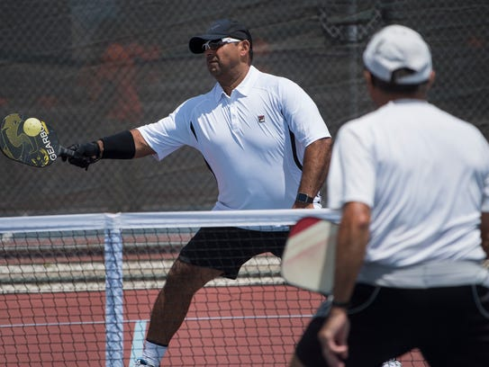 Peter Marin of Naples hits a shot during a pickup pickleball