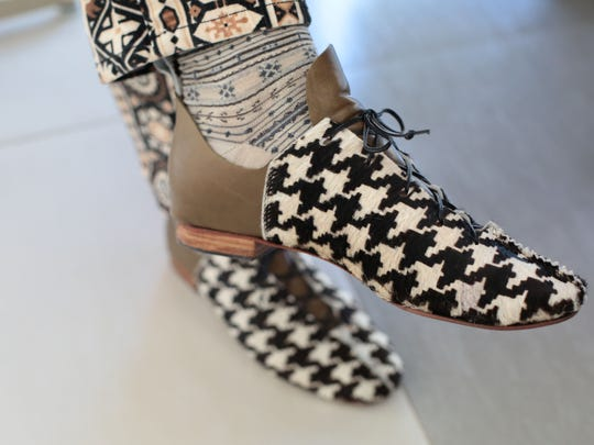 Debra Hovel, wearing one of her own creations, makes only custom shoes so no two pairs are alike.