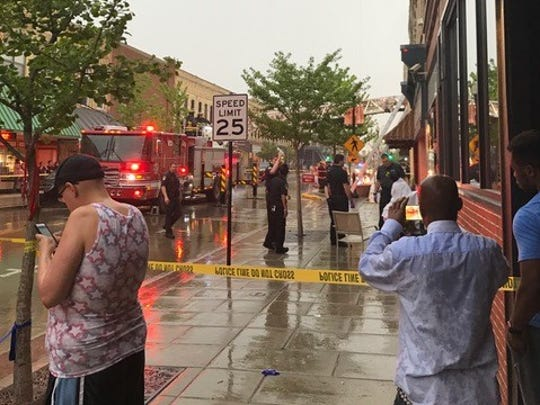 Onlookers watch as the Oshkosh Fire Department responds Monday, May 15, 2017, to a report of a fire in the 400 block of North Main Street.