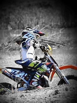Logan Lockwood displays his motocross skills in a recent race.