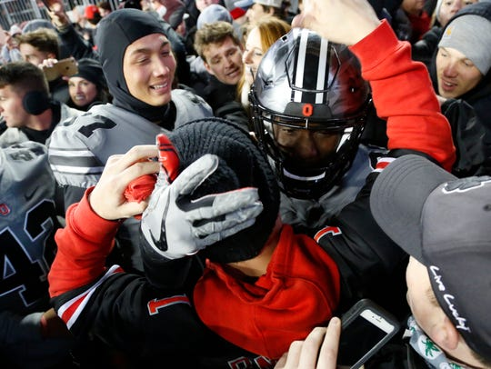 Ohio State Buckeyes running back Demario McCall celebrates