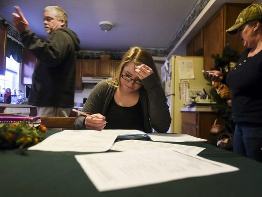Kristin Reed, 15, works on her mathematics homework