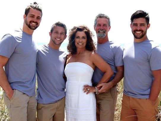 Carol Nemecek stands with her family, sons Josh, Joey