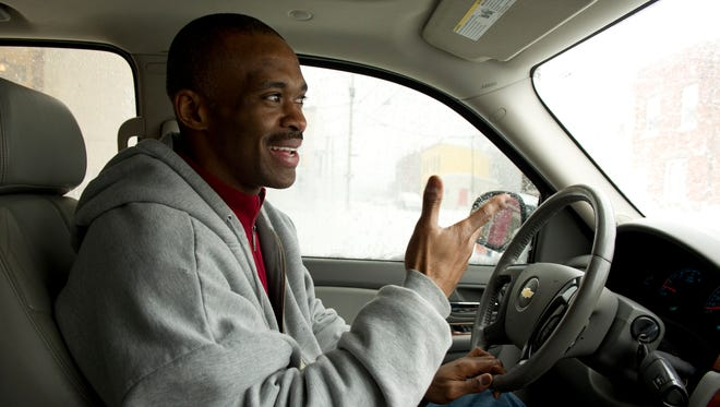 Former Indianapolis Colts wide receiver Marvin Harrison drives around North Philadelphia.