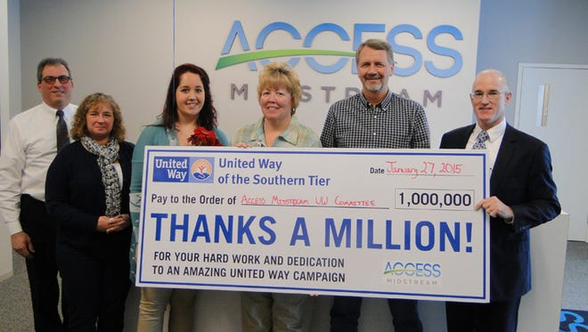 Volunteers at Access Midstream raised more than $105,000 for United Way of the Southern Tier. From left are Marty Castellana, United Way board member, Billie Demott, Stephanie Sandore, Margaret Lorden and Mike Tucker, all of Access Midstream, and Mark Clark, United Way board president.