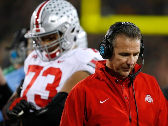 Ohio State head coach Urban Meyer, right, walks on the sideline during the second half of an NCAA college football game against Iowa, Saturday, Nov. 4, 2017, in Iowa City, Iowa. (AP Photo/Charlie Neibergall)