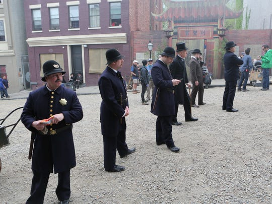 "Actors wait along Elm Street as the filming for the Cinemax series ""The Knick"" took place May 6, 2015 on Elm Street and Oak Street in Yonkers, as they transformed the area with old-time facades, dirt roads and horse and buggies."