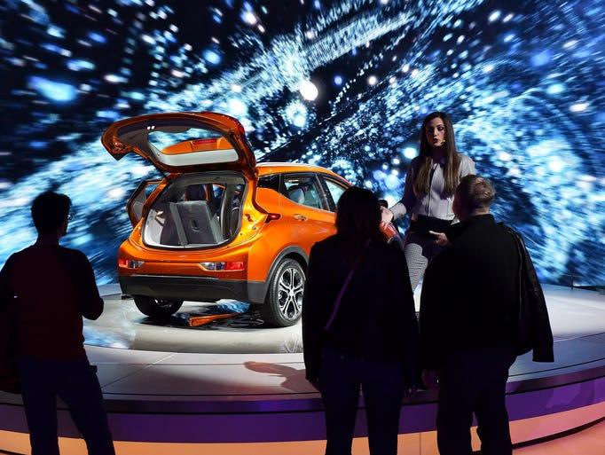 Chevrolet product specialist Maria Fotiu talks with