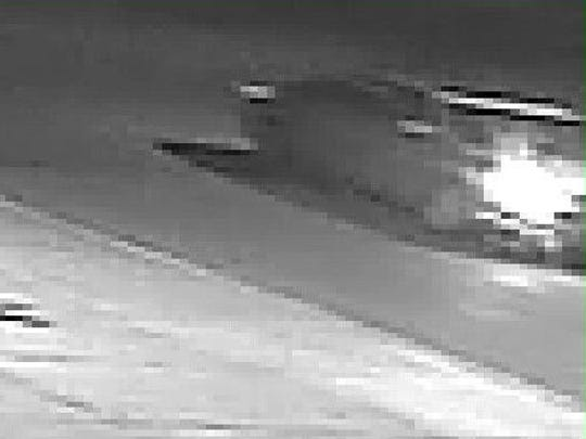 A still taken from surveillance video shows a light-colored