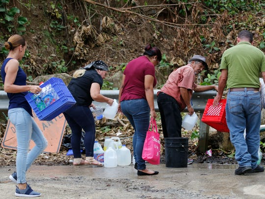 People gather water in the town of Comerio which is