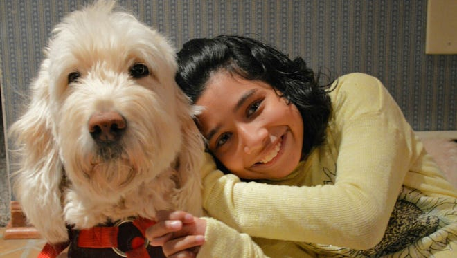 Ehlena Fry and her goldendoodle named Wonder in a Oct. 2015 picture. The U.S. Supreme Court  will consider her case if her family can sue for damages from a school district that balked at the service dog's presence in the classroom.