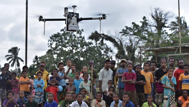 Matternet tests drones to deliver goods to people in Papua New Guinea. The company builds small flying vehicles that allow people to set up transportation networks and move critical goods.