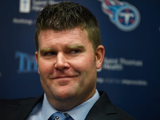 The Titans general manager Jon Robinson listens during