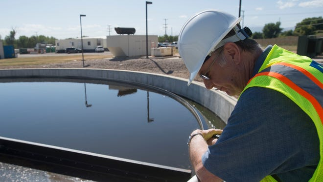Plant Manager Michael McCrary looks down into a clarifier at the Loveland Wastewater Treatment facility in Loveland. Water and wastewater rates in Loveland are on the rise due to infrastructure improvements to accommodate growth and new regulations.
