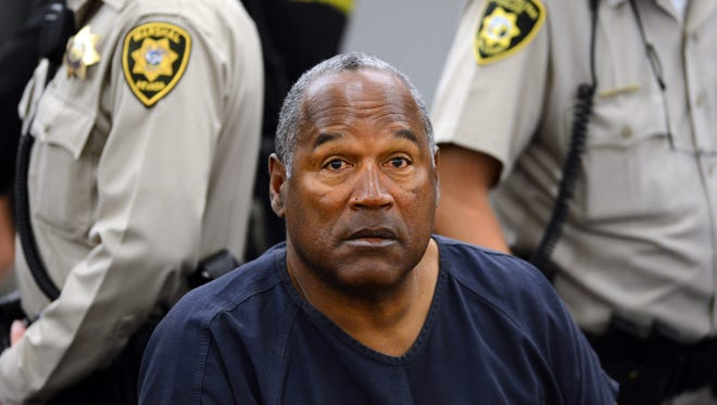O.J. Simpson sits during a hearing in Clark County District Court in Las Vegas on May 14, 2013.