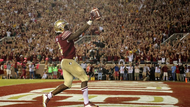 Florida State running back Dalvin Cook celebrates after scoring a touchdown against Miami last season at Doak Campbell Stadium.