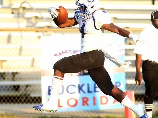 P.J. Simmons scampers for a touchdown as the Godby Cougars roll past the Leon Lions  at Gene Cox Stadium on Friday night.