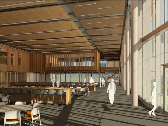 Preliminary designs for the interior of Tech High School feature warm wooden tones and natural light.