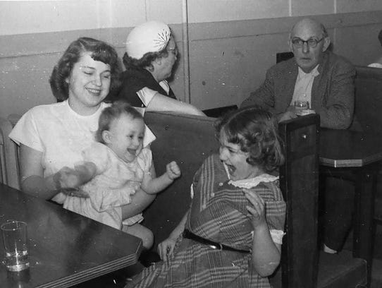 Mary Sullivan holds her daughter, Carol, while poking