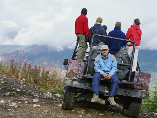 Man sitting in back of off road vehicle, portrait