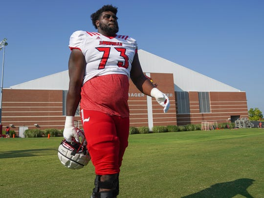 Louisville offensive lineman Mekhi Becton (73) walks onto the field before practice in Louisville, Ky., Wednesday, August 14, 2019.  Louisville Football Practice 019