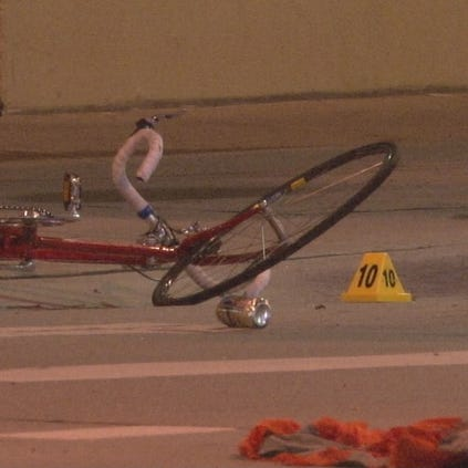 Denver Police said the bicyclist was riding the wrong way down the sidewalk off 17th St. and crossed in front of a car on Larimer St.