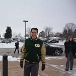 Gov. Scott Walker arrives at the Kewaunee County Administration building for a town hall meeting Thursday, Jan. 14.