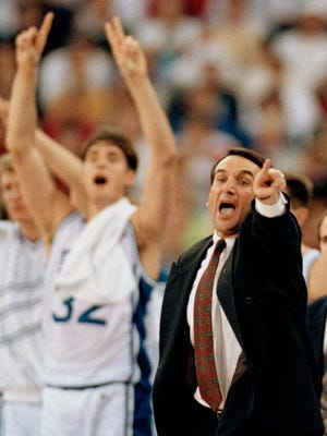 Duke coach Mike Krzyzewski directs his team as Christian Laettner cheers.