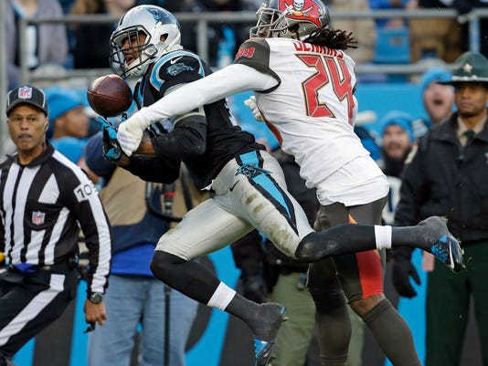 Carolina Panthers wide receiver Corey Brown, left, reaches for a pass as Tampa Bay Buccaneers cornerback Mike Jenkins, right, defends in the first half of an NFL football game in Charlotte, N.C., Sunday, Jan. 3, 2016. The pass was incomplete. (AP Photo/Bob Leverone)