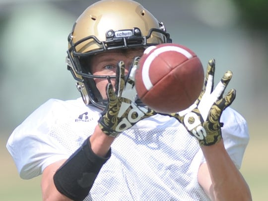 Abilene High's Colton Wilson catches the ball during