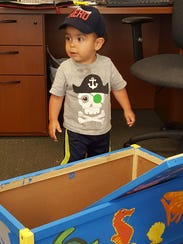 The first child to receive a toy box made by Cornerstone