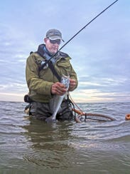 We caught keeper trout in a waist-deep tide, using