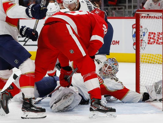 Florida Panthers goalie James Reimer (34) stops a Detroit Red Wings right wing Anthony Mantha (39) shot in the second period of an NHL hockey game Monday, Dec. 11, 2017, in Detroit. (AP Photo/Paul Sancya)