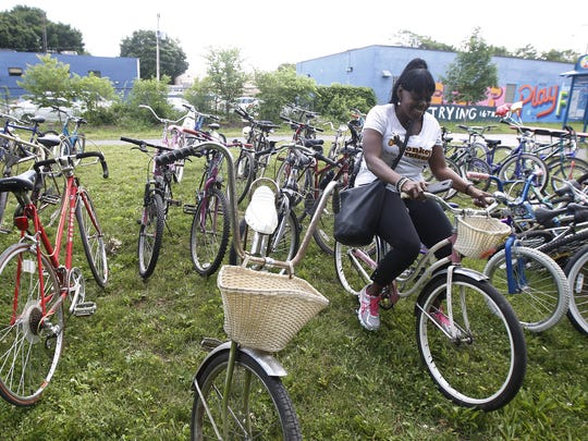 From 2015: Theresa Bowick, founder of the Conkey Cruisers, admires one of the older bikes donated to the group by the Democrat and Chronicle.