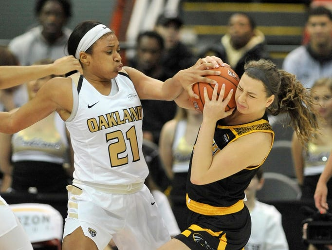 Oakland's Nola Anderson (21) tries to strip the ball